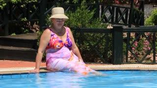 Woman sit by pool