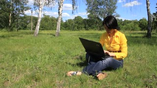 Woman with notebook on the nature