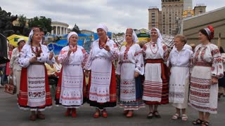 Women in Ukrainian traditional costume sing a Ukrainian song