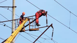 Working people. Electrical technicians repair high-voltage line