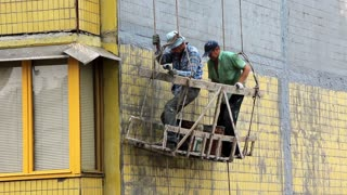 Working people. House painters. Steeplejacking