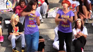 Young girls dance on the street