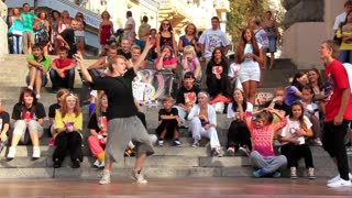 Young people dance on the street