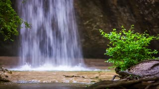 Fantastic scenery captured off the ground: beautiful small waterfall in the forest of the Crimea named Kozyrek falling on the ground and splashing making the shot very tranquil and relaxing. Good for