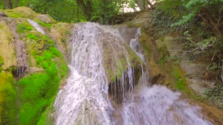 This is a downward shot of famous waterfall Dzhur Dzhur falling from rock into the lake splashing water around. Audio included. Captured in Crimea