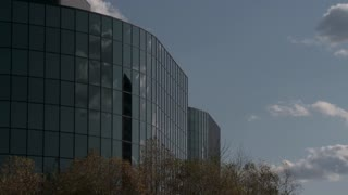 Urban Mirrored Buildings in a Kansas City business park with clouds in Time lapse.