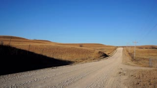 The Flint Hills of Kansas are a wild, natural prairie with the occasional Back Road of dirt to travel by.