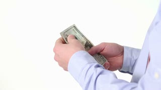 Adult male hands holding and counting cash