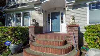 American suburban colonial style home departure; dolly shot