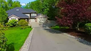American suburban home aerial approach