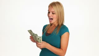 Attractive young blonde woman counting money