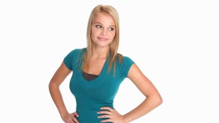 Attractive young blonde woman in casual attire posing against a white background