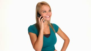 Attractive young blonde woman talking on a cordless phone