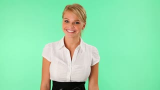 Attractive young businesswoman presenting blank space against a green screen background
