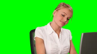 Attractive young businesswoman working at computer; alpha channel included
