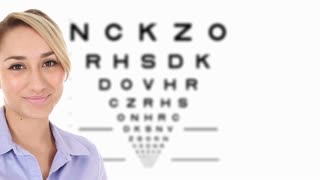 Attractive young Hispanic woman in eyeglasses with eye chart in the background