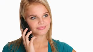 Attractive young woman talking to a friend on her cordless phone