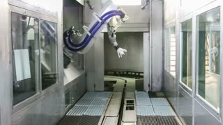 Automotive factory painter robot in action, going through the motions