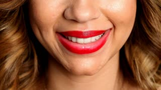 Beautiful young Hispanic woman with full lips wearing red lipstick whispering I Love You