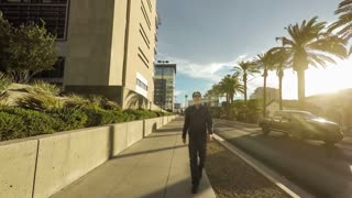 Conceptual clip of a man walking forward while the rest of the world moves backwards.