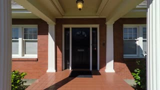 Departing from an American suburban colonial style home; dolly shot
