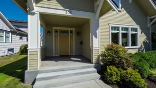 Departing from an American suburban craftsman style home; dolly shot
