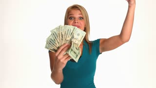 Excited young blonde woman with a bunch of cash money in her hands
