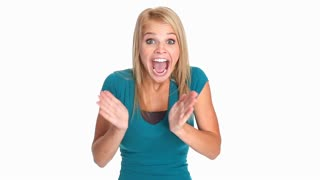 Excited young woman waving her hands and laughing enthusiastically