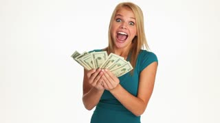 Excited young woman with a bunch of cash money