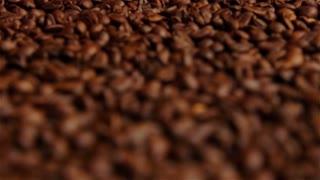 Fresh roasted coffee beans macro rolling focus