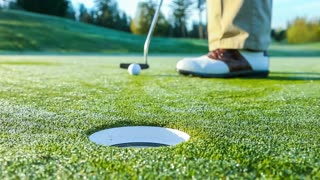 Golfer on the putting green sinks a short putt