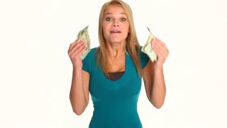 Happy attractive young blonde woman tossing cash into the air