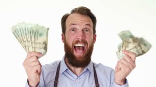 Happy enthusiastic man laughing with two fists full of paper money