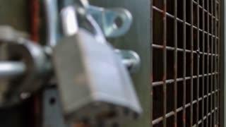 Metal gate locked securely with padlock