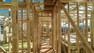 Moving through the interior of an unfinished American home in mid construction phase