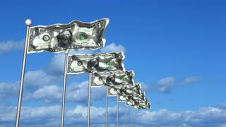 Row of dollar bill flags waving against a blue sky with clouds