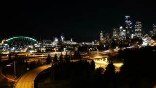 Seattle cityscape night time lapse with highway traffic
