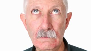 Senior adult man looks around with circling eyes