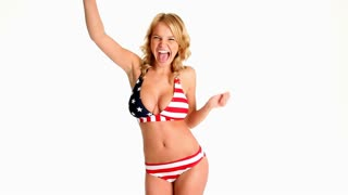 Sexy young blonde woman dancing in red white and blue bikini