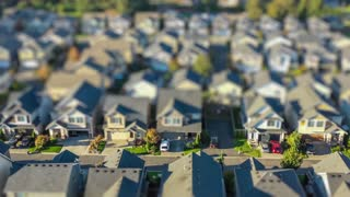4k footage of an aerial view fly-over of an American suburban neighborhood; tilt-shift lens effect to make houses appear as tiny toy models
