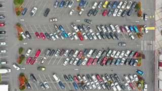 4k time lapse footage of a shopping mall parking lot, high angle view looking directly down