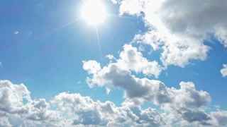 4k time lapse footage of dark storm clouds parting to show blue sky and bright sunshine