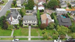 Aerial view of American suburban homes, rising jib shot