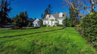 Approaching a quaint American Cape Cod style home; 4k dolly shot