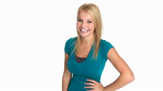 Casual young blonde woman in green tshirt laughing happily at the camera