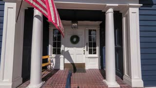 Departing from an American colonial style house; 4k dolly shot