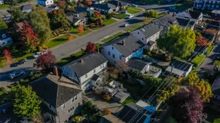 Flying over a small town suburban neighborhood on a sunny day