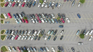 Time lapse footage of a mall parking lot, high angle view looking directly down