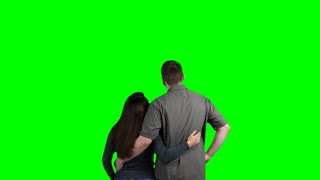 Young couple virtual shopping on a large green touch screen