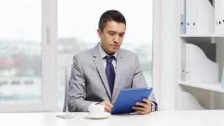 business, education, people and technology concept - businessman with tablet pc and coffee calling on smartphone in office